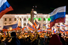 Pro-Russians celebrate in Simferopol, Ukraine, after polls  closed in Crimea's referendum on seceding from Ukraine. Photo / AP