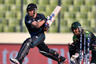 New Zealand captain Brendon McCullum attempts a reverse sweep as Pakistan's wicketkeeper Kamran Akmal takes his position during their Twenty20 World Cup warm-up match in Dhaka. Photo / AP