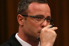 Oscar Pistorius listens to cross questioning during his trial in court in Pretoria. Photo / AP