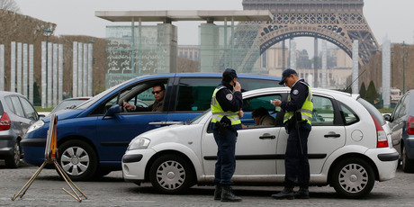 Police officers control vehicles near the Eiffel Tower in Paris. Photo / AP