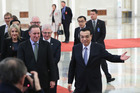Chinese Premier Li Keqiang, right, shows the way for New Zealand's Prime Minister John Key. Photo / AP