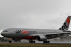 A Jetstar plane arrives at Auckland International Airport. Photo / Greg Bowker