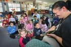 Ripeka Kireka reads a book to children at the Te Tirahou Early Childhood Education Centre at the Te Taiwhenua o Heretaunga, Hastings. Photo / Warren Buck