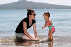 A happy Hayley McGregor, of Papatoetoe, has fun in the water with 22-month-old Reign Kent. Photo / Chris Gorman