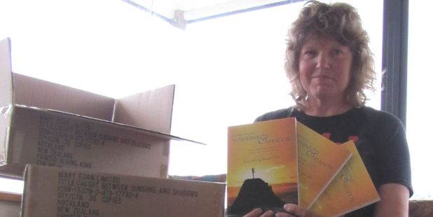 Georgie Tutt with her book Caught Between Sunshine and Shadow, will be at the Katikati Health and Wellbeing Expo on Saturday.