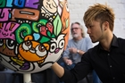Artist Jun Arita works on his egg for the Whittaker's Big Egg Hunt. Photo / Greg Bowker