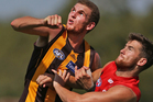 Kurt Heatherley, left, in action for the Hawks during the preseason. Photo / Getty Images