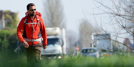 """French rogue trader Jerome Kerviel walks on a road to leave Modena on March 19, 2014, during his trek from Rome to Paris """"against the tyranny of the markets"""".  Photo / AFP"""