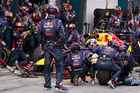 Red Bull mechanics perform a pit stop on the car driven by Daniel Ricciardo. Photo / AP