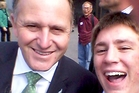 SURPRISE SELFIE: Gus Syben, 17, a Wairarapa College student, poses for a surprise selfie on the steps of the Beehive with John Key. PHOTOS/SUPPLIED