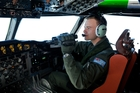Australian Air Force pilot Russell Adams scans the ocean thousands of kilometres from land. Photo / Getty Images