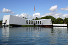 The USS Arizona memorial lies atop the wreckage, some of which protrudes from the sea. Photo / Thinkstock