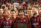 Johnathan Thurston of the Maroons and team mates celebrate winning game three of the ARL State of Origin series in July 2013. Photo / Getty Images