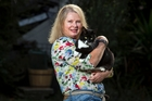 Runaway cat Randy and his owner, Suzanne Trewheela - reunited after five years. Photo / Michael Craig