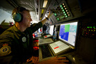 Royal Air Force Weapons Systems Officer, Flight Lieutenant Eric King, operates the tactical coordinator station during the search mission for Malaysia Airlines MH370. Photo / Australian Defence Force