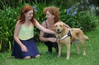 Lisa Reid, with daughter Maddison, now has Heidi as her guide dog.