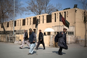 Afghans walk by the Serena hotel in downtown Kabul, Afghanistan. Photo / AP