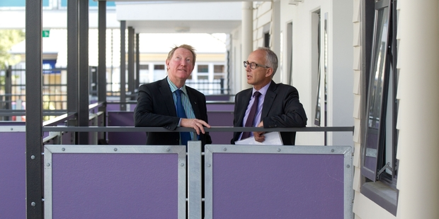 Housing Minister Nick Smith (left) and Housing NZ head Glen Sowry inspect the apartments. Photo / Richard Robinson