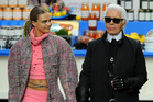 Fashion Designer Karl Lagerfeld (right) and model Cara Delevingne appear at the end of the runway during the Chanel show as part of the Paris Fashion Week. Photo / Getty Images