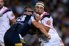 Sam Rapira of the Warriors is tackled by Tariq Sims of the Cowboys. Photo / Getty Images