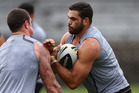 Greg Inglis is tackled by Luke Burgess during a South Sydney Rabbitohs NRL training session at Redfern Oval in Sydney, Australia. Photo / Getty Images