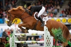 Katie McVean guides Dunstan Springfield over a jump in Hastings. Photo / Christine Cornege