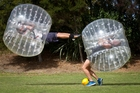 Cody Piper (left) and Paul Tremlett-Johnstone have a ball trying out Bubble Soccer at Albany Domain, on Auckland's North Shore. Photo / Richard Robinson