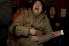 An anguished relative of one of the passengers lost on flight MH370. Photo / AP