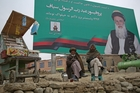 Abdul Rasoul Sayyaf, featured on the billboard, is one of a number of warlords involved in the election. Photo / AP