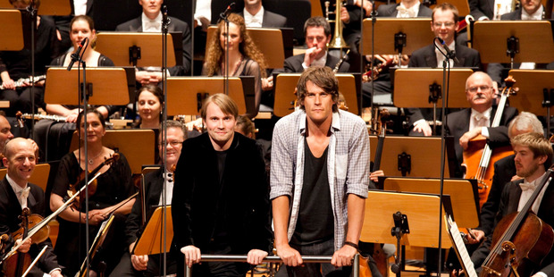 Jeremy Wells with the NZSO and their conductor Pietari Inkinen in The Grand Tour.