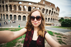 Snapping selfies in front of famous landmarks has become de rigueur for today's travellers. Photo / Yulia Mayorova