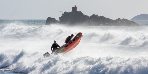 Mount Maunganui lifeguards head out in rough surf. Photo/Jamie Troughton/Dscribe Media Services