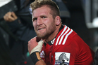 Kieran Read of the Crusaders sits on the sideline after leaving the field during the round seven Super Rugby match between the Crusaders and the Hurricanes. Photo / Getty Images.