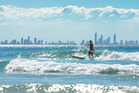 Paddle-boarding is popular in Currumbin.