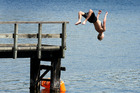 The Indian summer keeps the tempratures warm enough for swimming at Lake Pupuke in Takapuna. Photo / Brett Phibbs