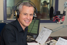 New Morning Report host Guyon Espiner in Radio NZ's Wellington studio. Photo / Mark Mitchell