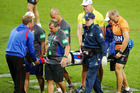Alex McKinnon of the Knights is carried off an a stretcher. Photo / Getty Images