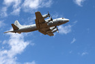 A Royal Australian Air Force AP-3C Orion takes part in the search for the missing plane. Photo / AP