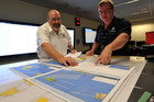 Mike Barton, rescue coordination chief, left, looks over the maps of the Indian Ocean with Alan Lloyd, manager of search and rescue operations at AMSAR. Photo / AP