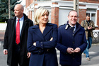 French far-right leader and National Front Party, Marine Le Pen, centre, and the Secretary General of the National Front, Steve Briois. Photo / AP