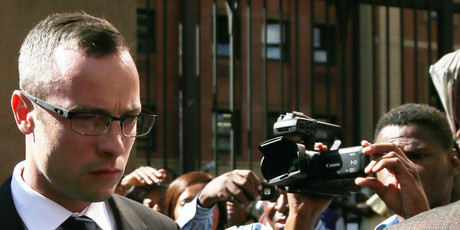Oscar Pistorius leaves the high court in Pretoria, South Africa. Photo / AP