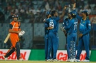 Sri Lanka's Ajantha Mendis, third left, celebrates with his teammates the wicket of Netherlands's Michael Swart, left, during their ICC Twenty20 Cricket World Cup match in Bangladesh. Photo / AP