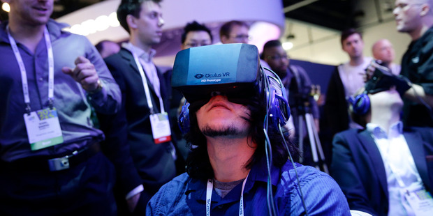 People play a video game wearing Oculus Rift virtual reality headsets the International Consumer Electronics Show, in Las Vegas. Photo/ AP