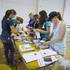 HBT140805-01 Team work putting together pamphlets. Photograph: Glenn Taylor