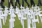 Whangarei High School students placing crosses at a past field of remembrance ceremony. PHOTO/FILE