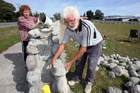 Stonemason Michael Dunn and his wife June are nearing the completion of a 70-m stone wall on High St.