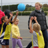 Central Pulse player Paula Griffin gives some tips to some young talent.