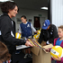 Nicki Lugt, junior netball coach for Hawke's Bay Netball, hands out goodies. All the children received a poster and a ball at the end of the day.