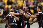 Warriors players celebrate the third try of Glen Fisiiahi during the round four NRL match between the New Zealand Warriors and the Wests Tigers. Photo / Getty Images.