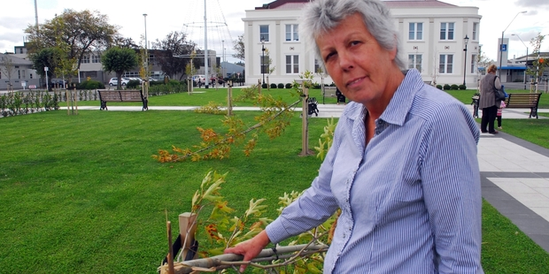 OUTRAGED: Masterton Mayor Lyn Patterson is fuming after vandals snapped in half a half-dozen sapling oriental plane trees overnight Saturday in the Masterton Town Square, which Mrs Patterson had helped open less than four months ago. PHOTO/NATHAN CROMBIE WTA230314NCSQUARE01